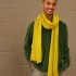 Elijah Williams rocks the sweater with bold bright scarf combination.