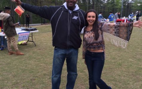Film festival planner Paige Overmyer celebrates the big success with Principal Douglass on the practice field.