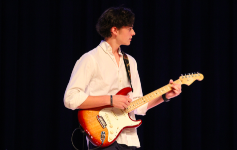 Band member Bradley Reeves performs with the rest of his band during the North Star talent show.