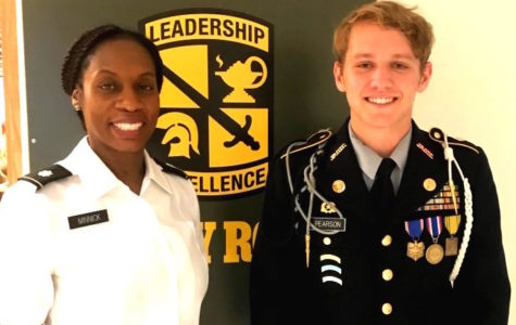 Battle On: Senior and Battalion Commander Fraser Pearson stands with JROTC Director Lt. Col Lynnette Minnick after being honored with the National Legion of Valor Bronze Cross Award.