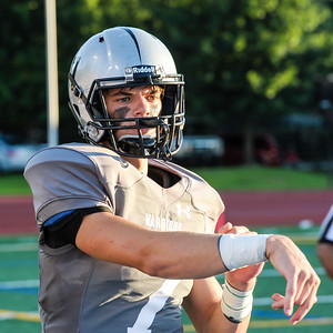 Dub Duds: Junior quarterback Wiley Hartley rocking Warriors' new unis on the sideline during 20-7 victory over Grady.