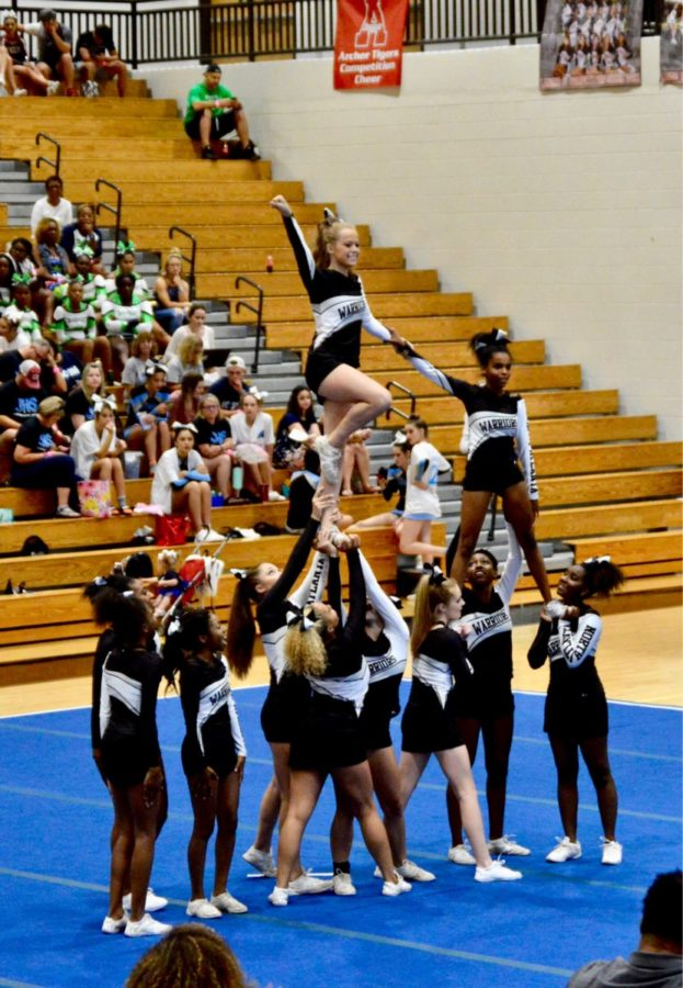 Ready, Set, CHEER: North Atlanta's competition cheer squad shows off their moves as a part of their dance routine.