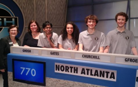 Brain Power: Seniors Quint Gfroerer, Jake Churchill, Ishaan Ghosh and Devon Gates stand together after their 2018 championship win on the High Q academic game show as a part of the Academic Quiz Bowl. They are shown here with APS board member Cynthia Briscoe Brown (far left) and Nancy Hunter, Quiz Bowl team faculty adviser.