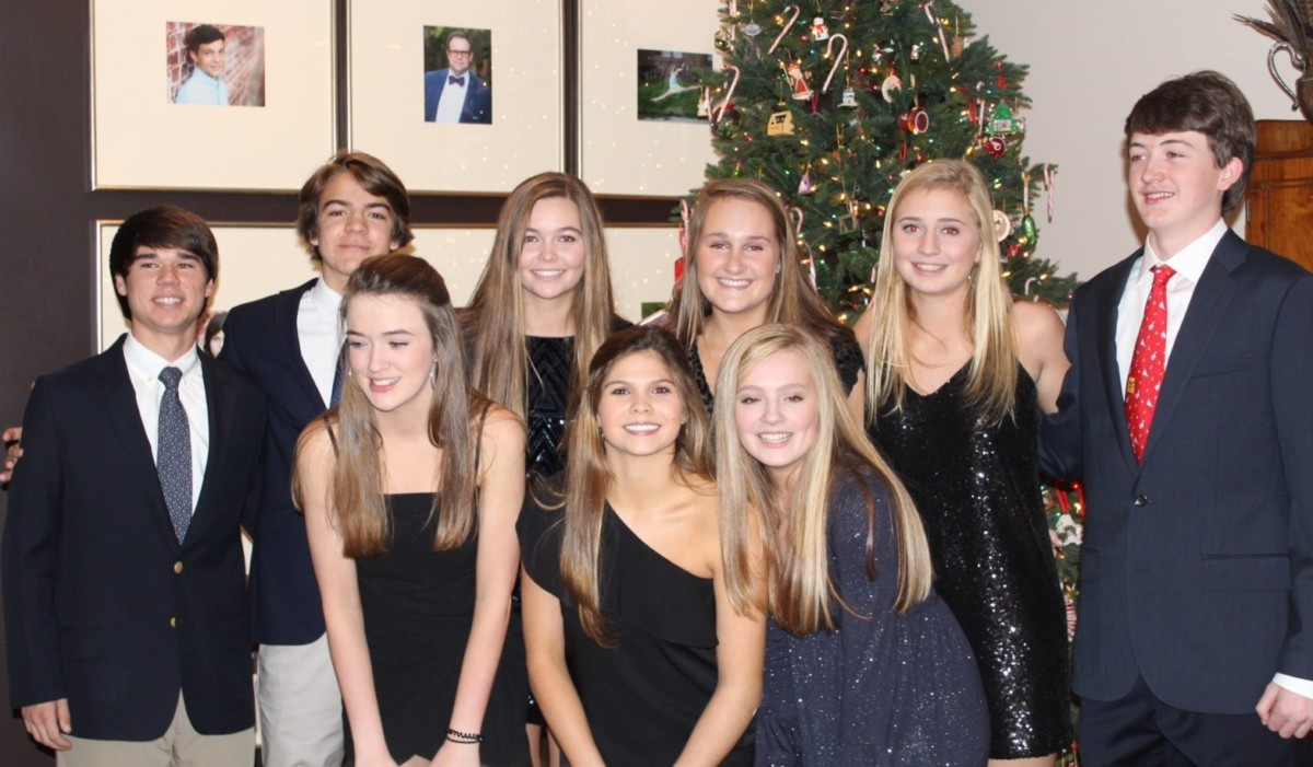 Juniors Molly Harrigan, Isabel Archer, Bridgett Breen, (front row) Parker French, Alex Sowatzka, Anna Pannell, Grace McCaffrey, Maddie Grice and Sam Harrigan (back row) all prepare for the largely popular and equally mysterious private PDC.