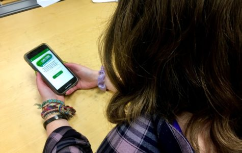 See No Evil, Hear No Evil, Speak No Evil: Sophomore Sophie Peck searches for the Say Something app that promotes the