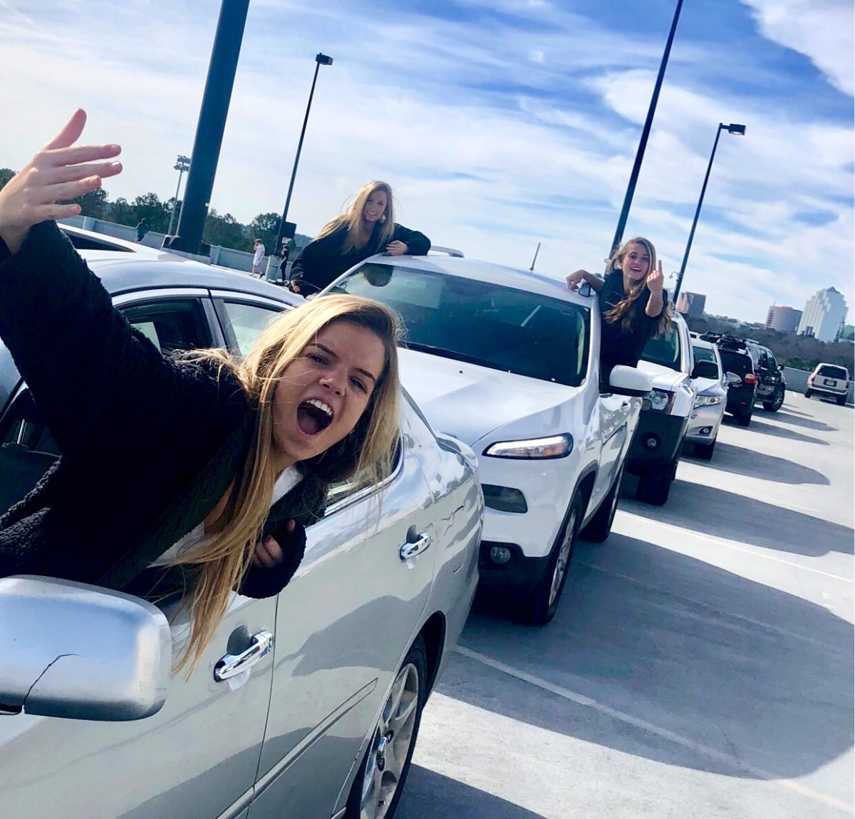 Through the Labyrinth: Sophomores Claudia Derek, Kate Jackson, Lexi Perry deal with the challenges of navigating through the parking deck traffic.