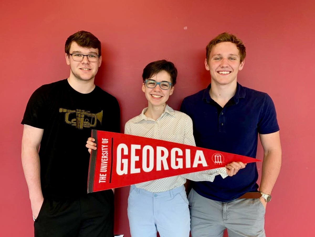 Bulldog Pride: Seniors Chris Carico, Mira Ratchev, and Fraser Pearson are one of the few looking foward to attending the University of Georgia this fall.