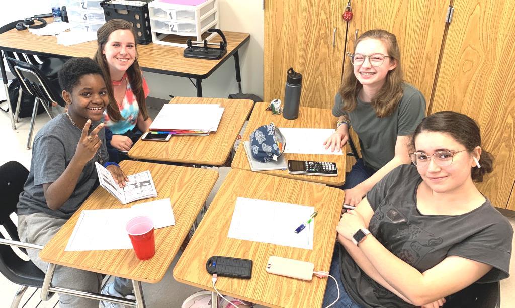 Hitting the Books: Freshmen Eliza Kennedy, Andrew Weeks, Kathryn Ackerman, and Natalia Perez study hard during their ELT class.