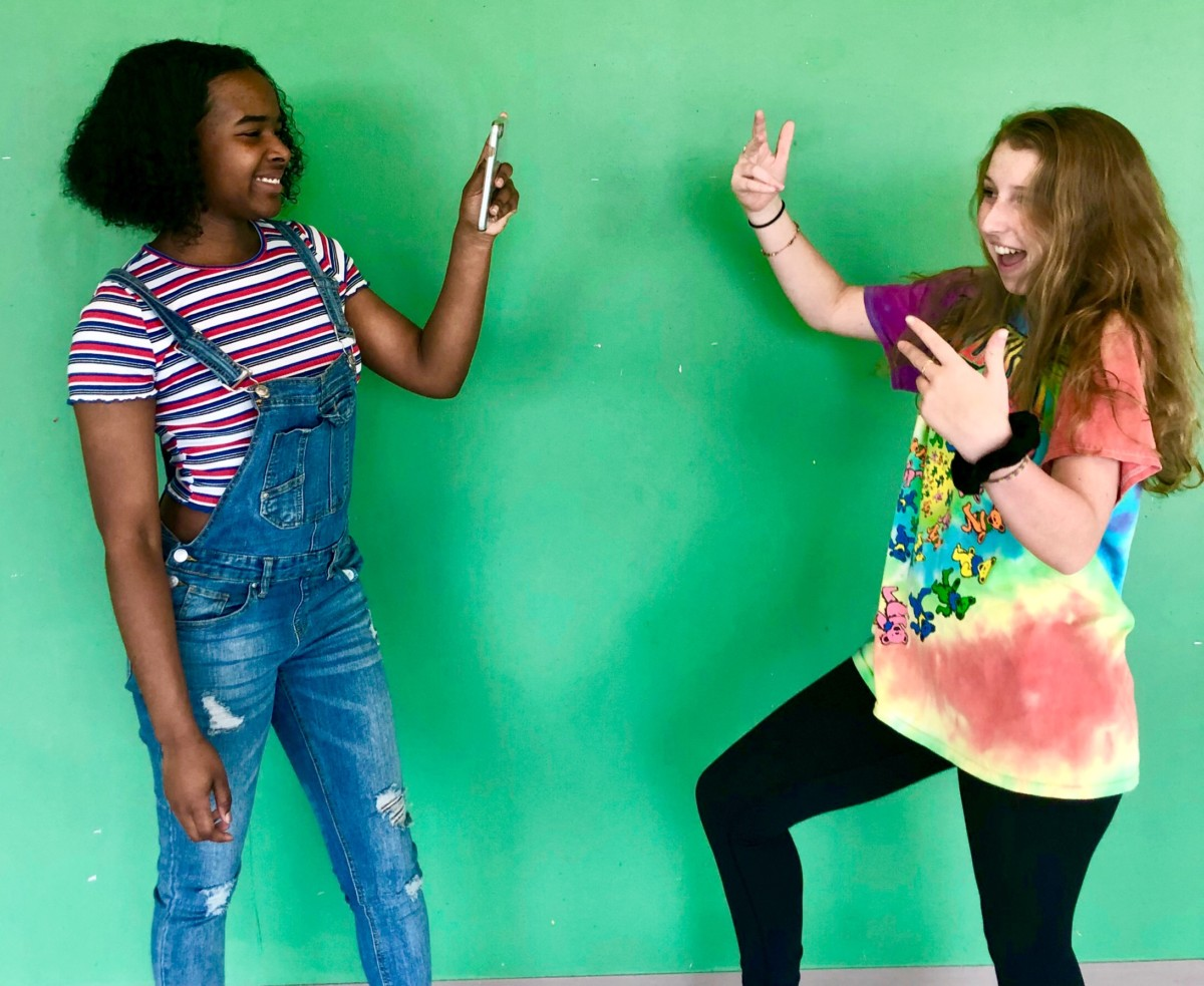 Clocked Out: Sophomores Luella Dennis and Amaya Bacon use TikTok to create short, fun videos for entertainment.