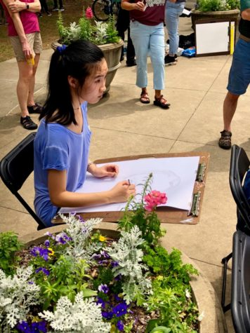 A student attending the Dogwood Festival participates in the art activities set during the events.