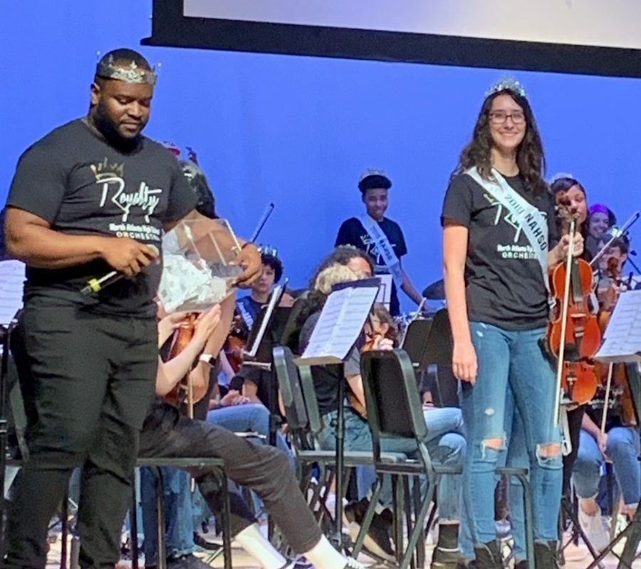 Senior+Moment%3A+Violinist+Lila+Ward+was+one+of+many+orchestra+seniors+honored+during+the+April+25+Spring+Concert.+She+is+shown+on+stage+here+with+orchestra+director+Stephen+Lawrence.+