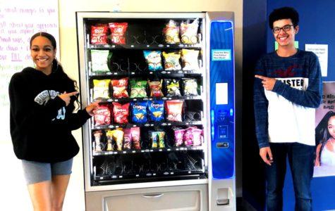 Super Snacks: Seniors Ayla Amomah and Mahki Lloyd admire the new vending machines all over the North Atlanta halls.