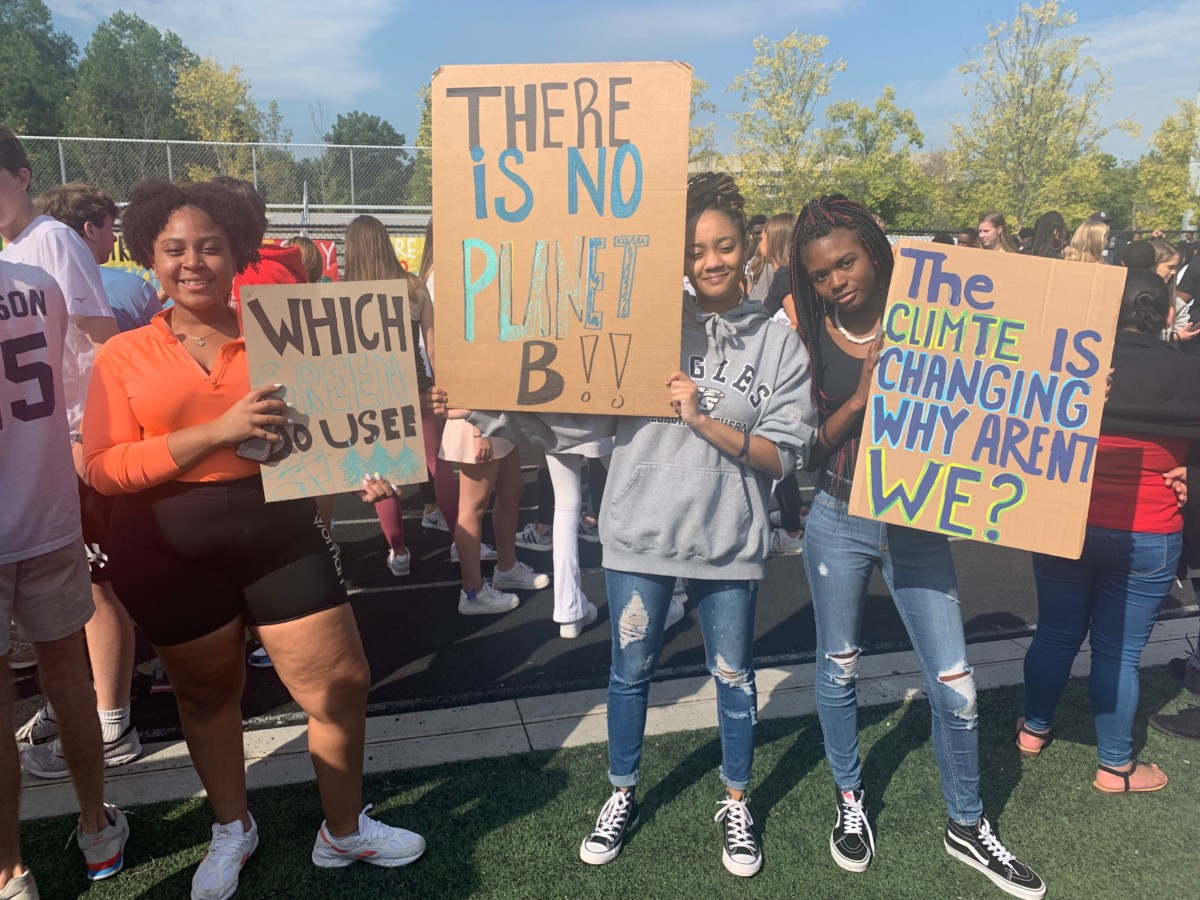Marching for a Cause: North Atlanta seniors (left to right) Janejha Jones, Aria Thomas, and DeAsia Doser. walk out of class to raise awareness of climate change