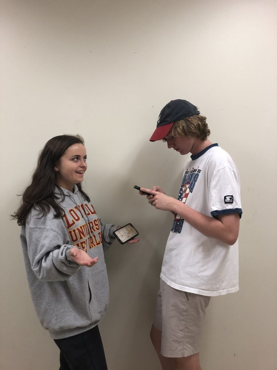 Phone Fiends: Students are phone obsessed (Left to Right Kate Whilloby, Foard Martin, both juniors)
