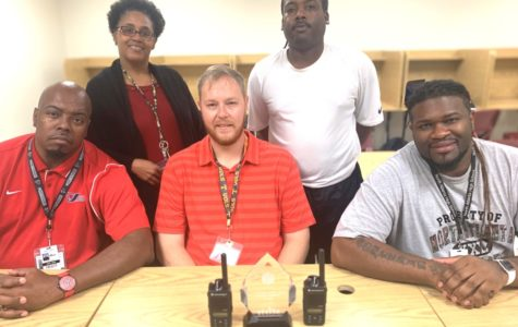 """Monitoring Progress: The school's dedicated hall monitors are committed to ensuring that students are in class. Shown are (front) Jermaine Stephans, Ture Mackall and William Leonard. Back row are Carolyn Robinson, ISS coordinator, and Lee Hill. The hall monitors and Robinson recently won the school's """"It Takes a Village Award"""" in recognition of their hard work. Photo Credit: Michael Dobson"""
