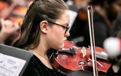 String Thing: Sophomore violinist Sydney Heaton makes music along with her colleagues as a member of the North Atlanta Orchestra. Cady Studios