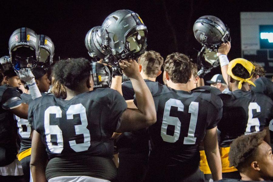 Triumphant: The Dubs raise their hats to break down a dominant team win over Centennial.