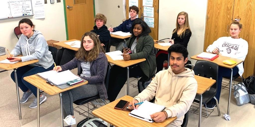 Operation Avoid Tests: Students are chattering about changes to the policies associated with who can and cannot exempt their end-of-semester finals. Shown are students in Ms. Lashawne Miles' Algebra 2 class: Front row: senior Sandra Zurita, junior Aaliyah, Roach, sophomore Jairo Venancio; middle row: junior Mitchel Harbolt, junior Destini Togba; back row: sophomore Bryce McGowan, junior Graham Barnette and junior Kate McCabe.