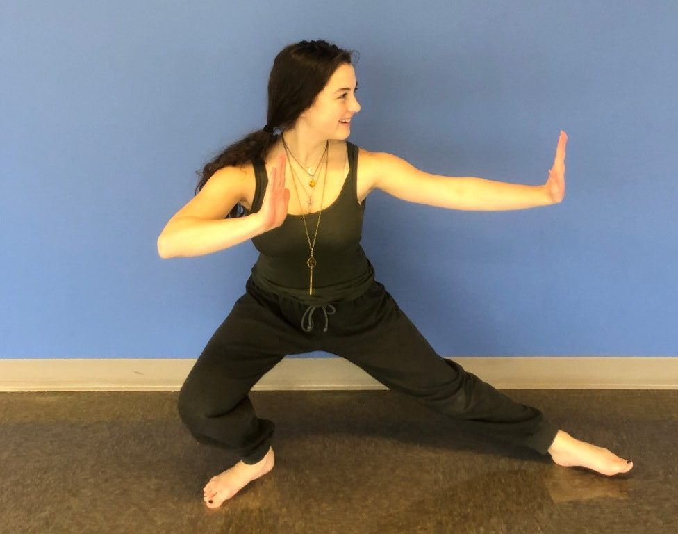 Every Now and Zen: Sophomore McKenna Weinbaum strikes the Warrior Pose as she leading her schoolmates toward zen and meditative peace through the founding of the new North Atlanta Yoga and Meditation Club.