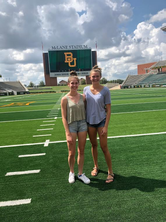 Beaming at Baylor: Juniors Caitlin Hohenstein and Maddie Bartlett smile as they take in the scenery at Baylor University