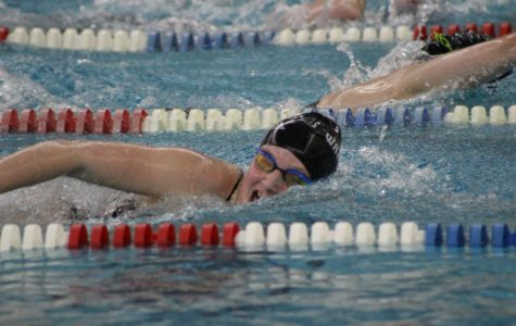 Caption: Junior Zoe Mock swims a fast freestyle for her relay showing of that Warrior talent!