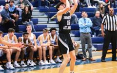 Basketball Star:Charlie Hamilton hoists up a jumper versus Cambridge.