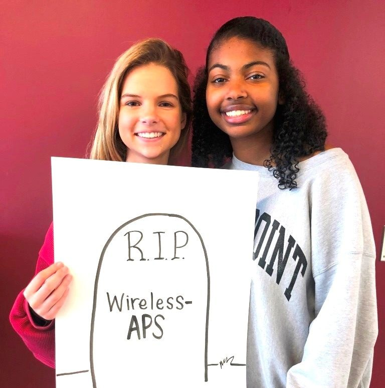 Broadband+Blues%3A+Juniors+Claudia+Derrick+and+Payton+Jones+are+among+those+students+who+have+been+challenged+by+seeming+end+of+the+readily+accessible+APS-provided+Wifi+at+North+Atlanta.+