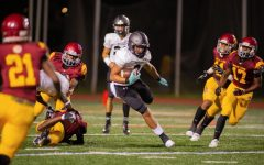 Senior running back Tre Mason scampers for yardage among Maynard Jackson defenders.