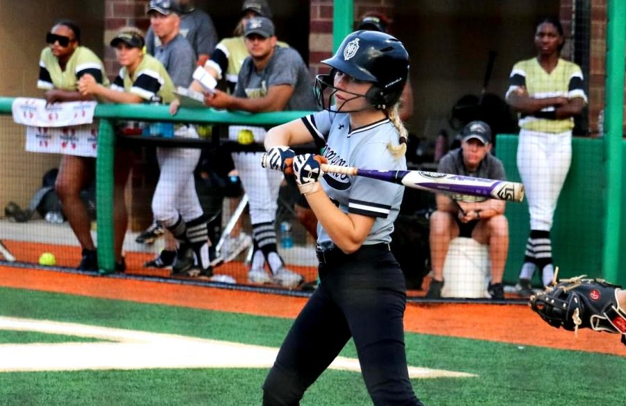 Fall Into Sports: Senior Katherine McWhirter takes her best swing at the plate during a recent Dubs softball game against Mountain View. For all North Atlanta sports teams, new challenges – beyond just heady competition – are presenting themselves in a COVID-impacted sporting environment.