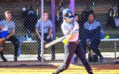 Softball Slammer: Sophomore Cece Smith is poised to hit that ball right out of the park.