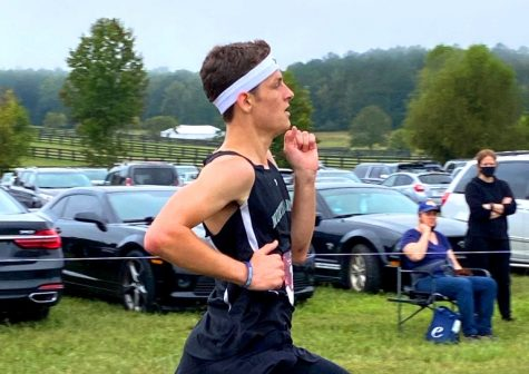 Going the Distance: Senior Warrior runner Ethan Curnow is having a breakout season along with the entire boys cross country team. Both Dub harrier teams -- boys and girls -- are making a strong run for the state playoffs.