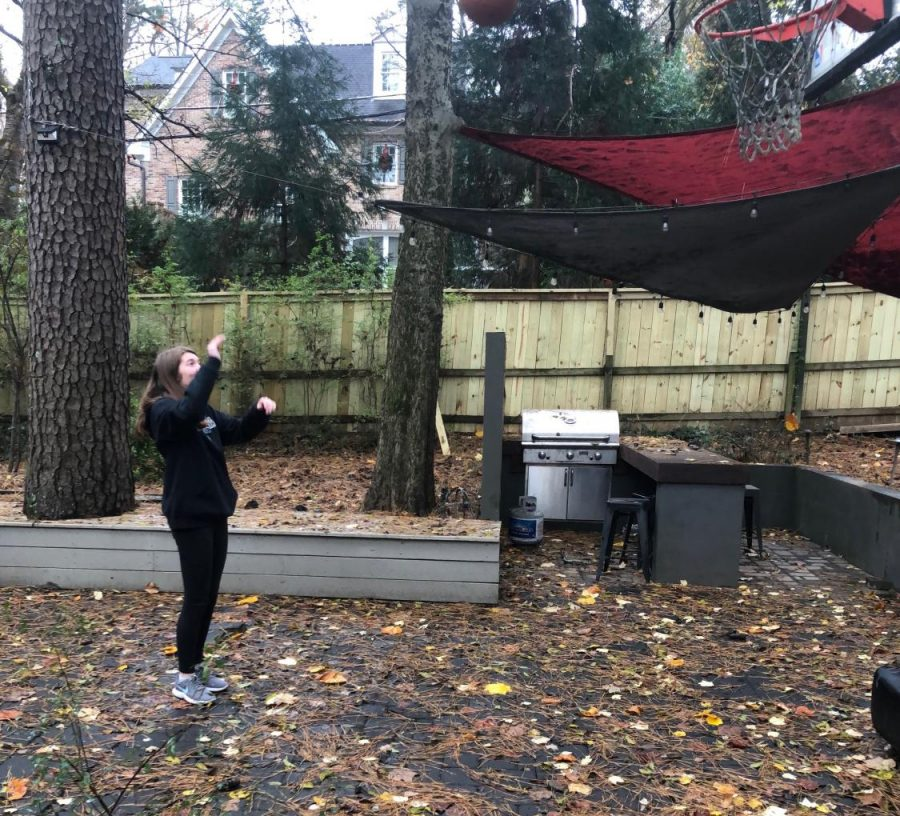 Nothing But Net: Sophomore Kate Zappa brushes up on her basketball skills to get in shape over quarantine.