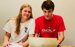 Virtual Vacations: Online school has many negatives, but many students are able to see the positives by doing school from almost anywhere! Shown above are sophomores Caroline Edwards and Lucas Savage concentrating in class together.