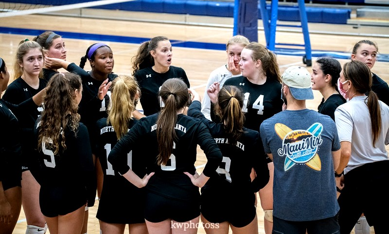 The Warriors volleyball team pulled in for a timeout to talk strategy for its last game of the season against Pope High School. The team fought hard in its efforts to win the match and move forward to the Region 6A Final Four.