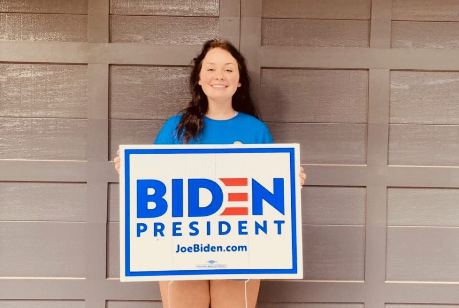 Let's Get Political: Politics is a very prevalent topic in today's society, and Dubs are no exception. Some students find that with access to a greater amount of information, they may develop beliefs different from that of their parents. Shown above is sophomore Juliette Holzworth sporting the sign of the political candidate she supports.