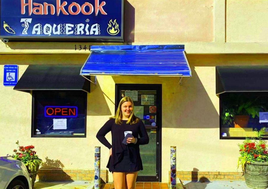 Taco Tuesday: Junior Katy Wilbanks stands outside Hankook Taqueria, a whole in the wall restaurant that serves up a fusion of Korean-Mexican delight.