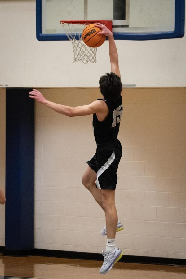 North Atlanta senior Charlie Hamilton (15) throws down a dunk.