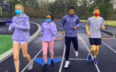 Race Is On: Even in the face of COVID challenges, Warrior spring season athletes are rushing headlong into competition. The track and field team under the direction of Coach Bryce Doe is one of many sports teams readying itself for competition to come. Shown here training on the North track are freshman Catherine Townsend, sophomore Se'Lah Robinson and seniors Syre Stewart and Ethan Curnow.