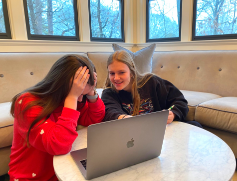 Taylor Swift Fever: Shown above from left to right are sophomore staff writers Tanner Adams and Caroline Edwards making the tough choices of ranking Taylor Swift