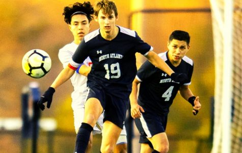 Team Leader: Senior midfielder Danny Gardner, a team captain, has led the North Atlanta team in scoring and has played his heart out for the region champs. Behind him on the pitch is junior wingback Michael Garcia.