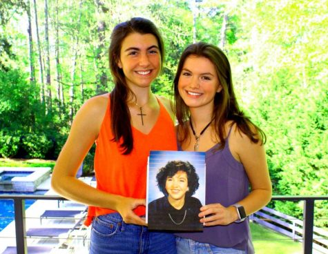 A Cousin Remembered: Junior Evelyn Iwanicki and sophomore Tanner Adams hold a photo of their cousin Madeline Adams who died in 1992 at age 24, long before the current North Atlanta students were born. To honor the memory of their relative who died after a fight against blood cancer, the first cousins spearheaded a fund-raising campaign for the Leukemia & Lymphoma Society and in the process raised more than $100,000 to fight the disease that took their relative's life.