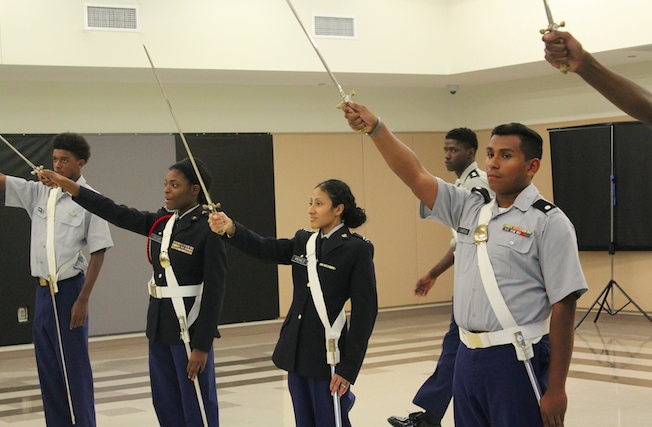 Students in the JROTC program practice in uniform during their class.