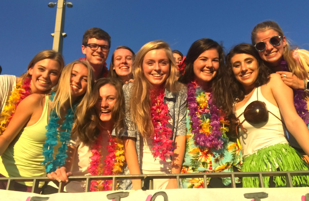 North+Atlanta+seniors+are+amped+up+in+the+on-fire+student+section+during+the+Aug.+18+Warrior+victory+over+arch-rival+Grady.+The+Warrzone+theme+for+the+game+was+a+Hawaiian+luau.+%0A