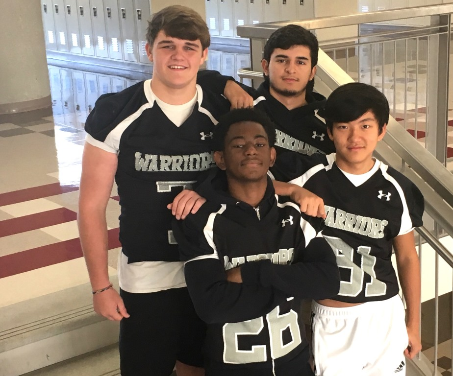 "The Name Game: For every Warrior football player, there's likely a catchy team nickname. Pictured are (front, l to r) Mitchell ""Sauce"" Harris, Matthew ""Toshi"" Yim (back, l to r) Davis ""Diesel"" Bell and Ale ""Leg"" Marin. Shemar Williams"