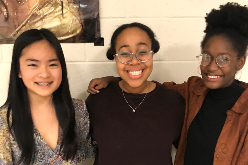Performance-Based Club: Glee Club members Fiona Liu, Lenox Johnson and Sydney Jones strike a harmonious pose at the group's recent interest meeting. Olivia Chewning