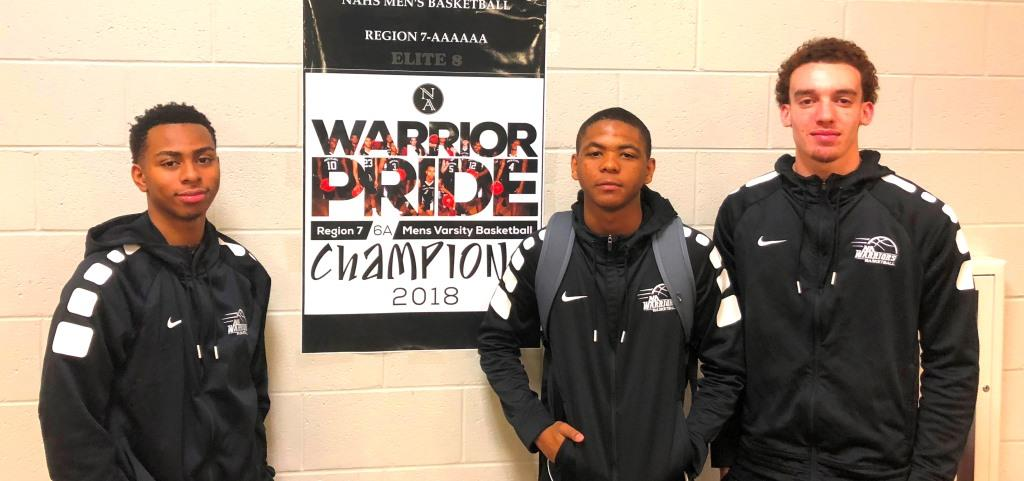 Push To The Final Four: The Warriors are on an amazing run and a win against Heritage could get them to the Final Four. Shown left to right are junior Messiah Thompson and seniors Desmond Thomas and Andrew Stimpson.