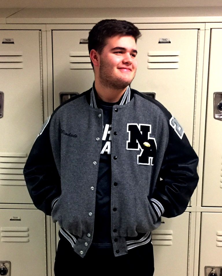 Varsity Style: Sophomore football player William Winslade goes all in for the black and silver and reps for his high school with a letterman's jacket.
