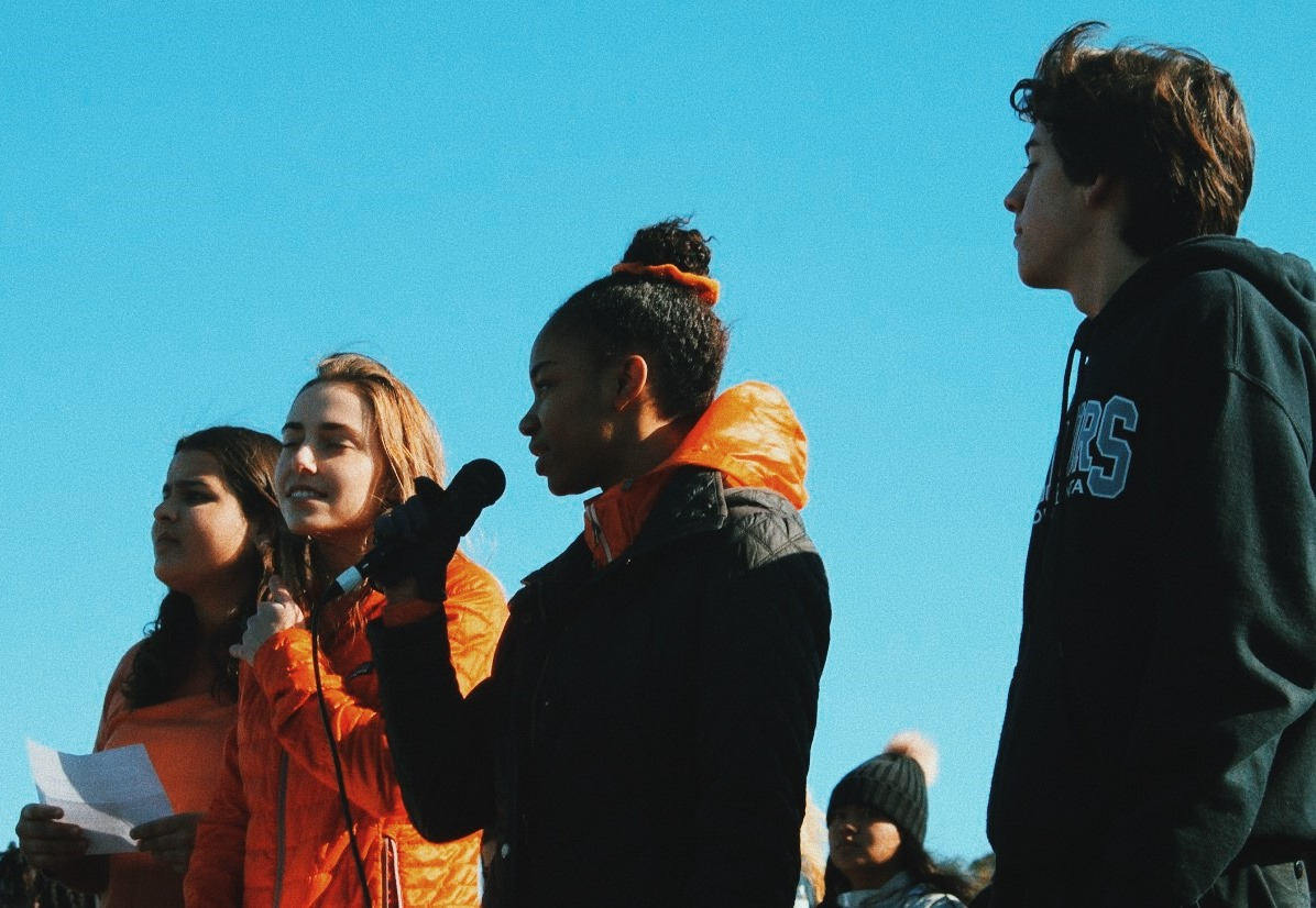 During a March 14 walkout event at North Atlanta High School, senior Adenike Makinde read a list of the names of the 17 victims who were killed during the Feb. 14 school shooting in Parkland, Florida. Also shown are Roya Register, Jessica Milburn, and SGA President Chandler Smith