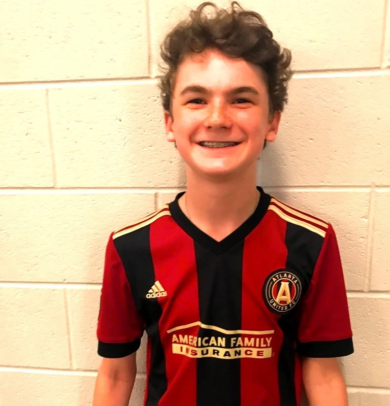 Five+Stripes+Fanatic%3A+Sophomore+Bennett+Speir%2C+repping+his+favorite+team%2C+is+one+of+many+Atlanta+United+fanatics+found+among+North+Atlanta+students.+.