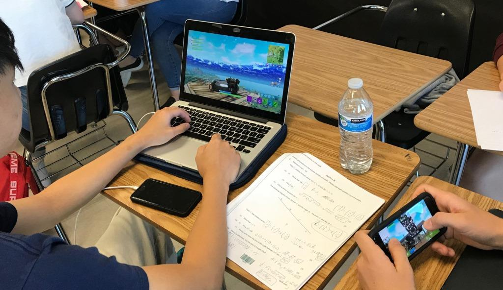 Gamers Galore: North Atlanta students Henson Hugh and Luca Kurtz take advantage of some down time to catch up on playing Fortnite, the newest video game craze.
